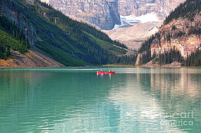 Lake Louise With Canoes Poster