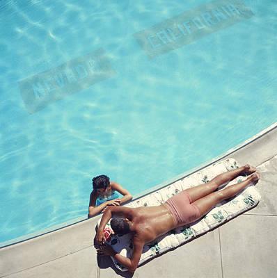 Lake Tahoe Couple Poster by Slim Aarons