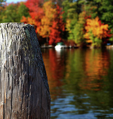 Lake Winnepesaukee Dock With Foliage In The Distance Poster