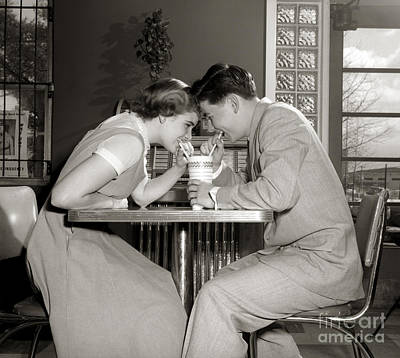 Laughing Couple Sharing A Drink Poster
