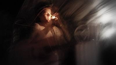 Poster featuring the photograph Lighting The Cigarette by Karen Musick