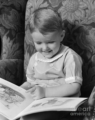 Little Boy Reading A Picture Book Poster by H. Armstrong Roberts/ClassicStock