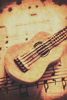 Little Carved Guitar On Sheet Music Poster by Jorgo Photography - Wall Art Gallery
