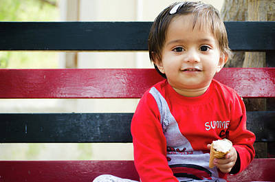 Little Girl Sitting On A Bench And Eating An Ice-cream Cone Poster