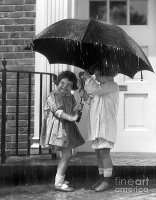 Little Girls Sharing An Umbrella Poster by H. Armstrong Roberts/ClassicStock