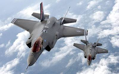 Lockheed Martin F-35 Lightening II Joint Strike Fighters Poster by L Brown