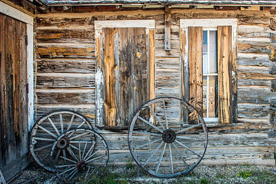 Log Cabin And Wagon Wheels Poster by Paul Freidlund