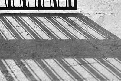 Poster featuring the photograph Long Shadow Of Metal Gate by Prakash Ghai