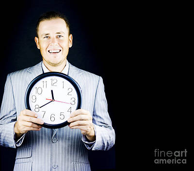 Male Business Person In Gray Suit Holding A Clock Poster
