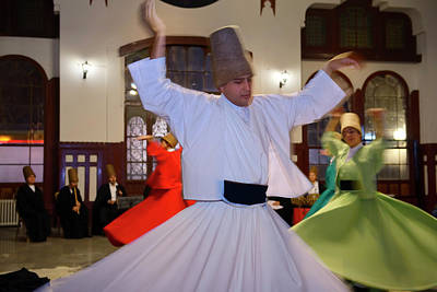 Male Sufi Whirling Dervish In A Sema Ceremony With Musicians And Poster