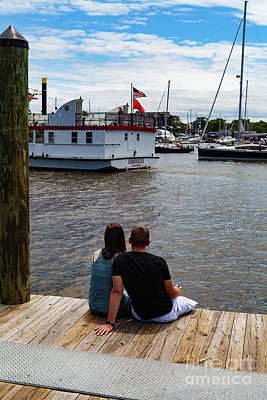 Man And Woman Sitting On Dock Poster