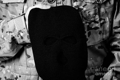 Man In Combat Fatigues Holding Black Ski Mask Balaclava Poster by Joe Fox
