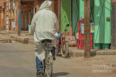 Man In Djellaba On Bike Poster