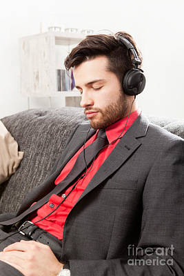 Man In Suit Listening To Music With Headphones Poster by Wolfgang Steiner