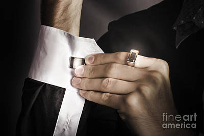 Man Putting Stylish Cuff Links On His Shirt Poster