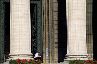 Man Reading A Book Beside The Columns Of La Madeleine Church In Paris Poster by Sami Sarkis