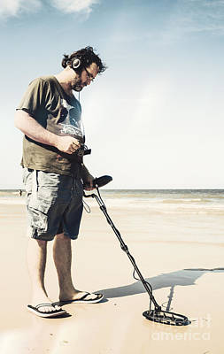 Man With Metal Detector On Beach Poster
