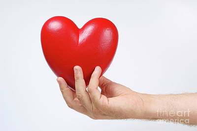 Man's Hand Holding Heart-shaped Object Poster