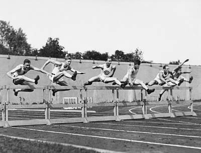 Men Running High Hurdles Poster by Underwood Archives