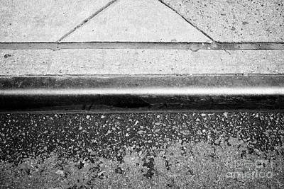 metal curb edge on city street New York City USA Poster