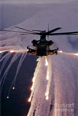Mh-53j Pave Low IIie Expends Flares Poster by Stocktrek Images