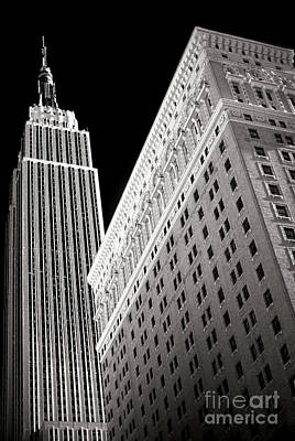 Poster featuring the photograph Midtown Empire by John Rizzuto