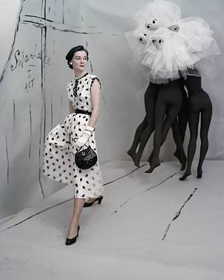 Model Standing In Set By Verts Wearing Poster by Conde Nast