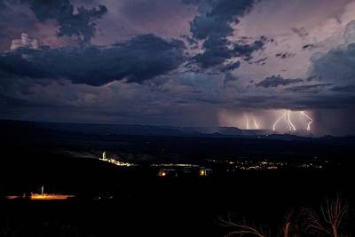 Poster featuring the photograph Monsoon Lightning Over Sedona From Jerome Az by Ron Chilston