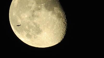 Moon And Plane Over Sanibel Poster by Melinda Saminski