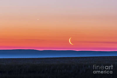 Moon And Venus Rising Over The Flat Poster by Alan Dyer
