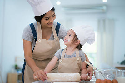 Mother And Daugthter Cooking Togather Poster