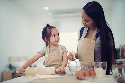 Mother And Daugthter Cooking Togather For Make Bread For Dinner Poster