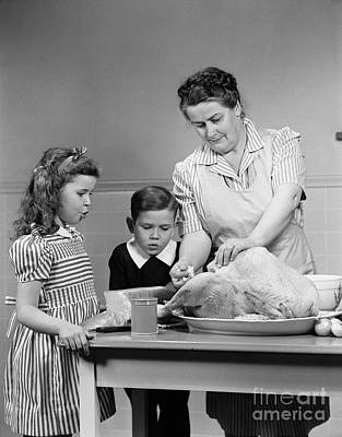 Mother Stuffing Thanksgiving Turkey Poster by H. Armstrong Roberts/ClassicStock