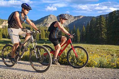 Mountain Biking Couple Poster by Utah Images