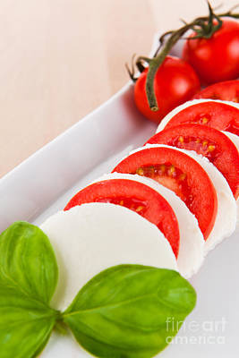 Mozzarella Salad With Tomatoes And Basil On A Wooden Table Poster by Wolfgang Steiner