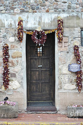 Poster featuring the photograph New Mexico Red Chili Ristras Door by Andrea Hazel Ihlefeld