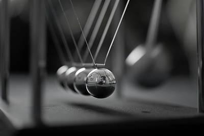 Newton's Cradle In Motion - Metallic Balls Poster by N.J. Simrick