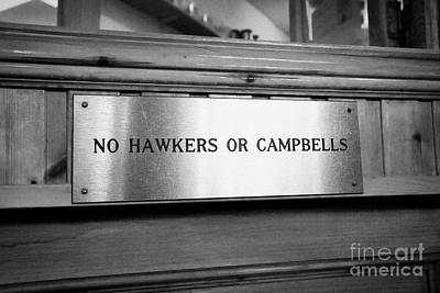 no hawkers or campbells sign in the clachaig inn site of the massacre of glencoe Scotland UK  Poster by Joe Fox