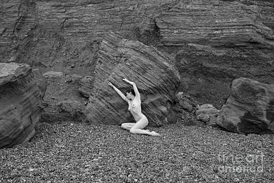 Nude Woman Pulling Shape By Rocks Poster