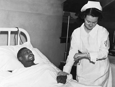 Nurse Taking Man's Pulse Poster by Underwood Archives