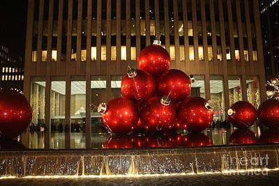 Nyc Giant Christmas Tree Ornament At Night Poster by John Telfer