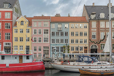 Poster featuring the photograph Nyhavn Waterfront In Copenhagen by Antony McAulay