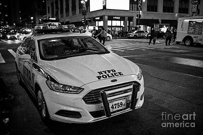 nypd ford fusion police cruiser parked on the street at night New York City USA Poster