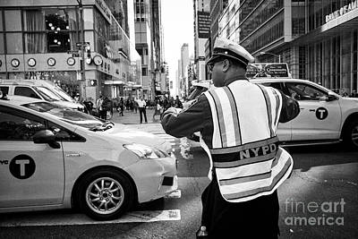 nypd traffic officer with whistle in mouth directing traffic on 6th ave New York City USA Poster