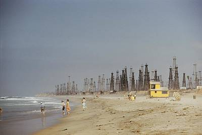 Oil Rigs Line Huntington Beach Poster by J Baylor Roberts