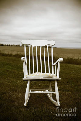 Old Rocking Chair In A Field Pei Poster by Edward Fielding