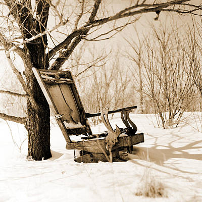 Old Rocking Chair In Snowy Woods Sepia Toned Poster by Donald  Erickson