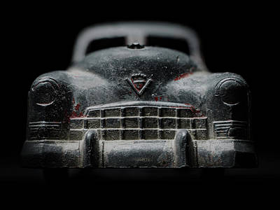 Old Silver Cadillac Toy Car With Specks Of Red Paint Poster