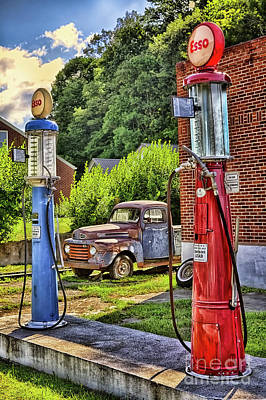 Poster featuring the photograph Old Time Vintage Gas Pumps by Dan Carmichael