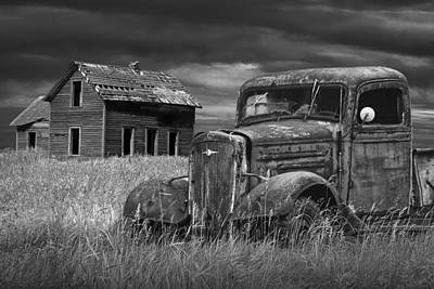 Old Vintage Pickup In Black And White By An Abandoned Farm House Poster